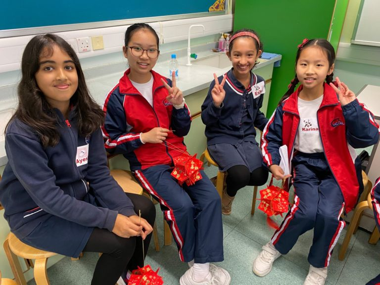 Girls posing for a photo at the French International School