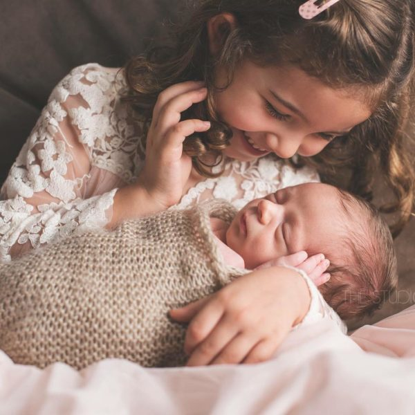 Little Girl Holding Baby Brother/Sister By The Studio Loft